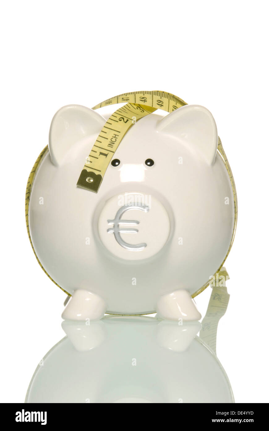 Piggy bank with Euro currency sign and tape measure, symbolic image for savings in Europe - Stock Image