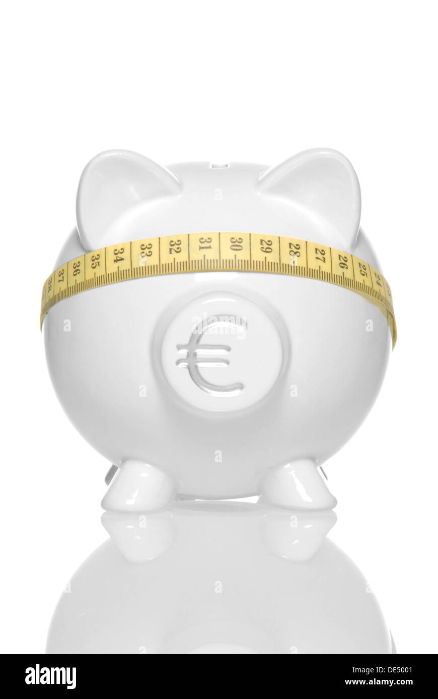 Piggy bank with Euro currency sign and tape measure over its eyes, symbolic image for 'blind' savings in Europe - Stock Image