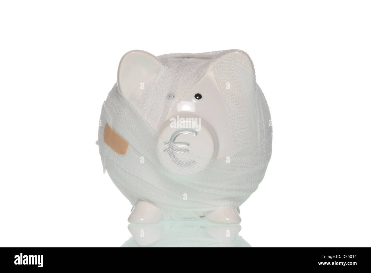 Bandaged piggy bank, symbolic image for the ailing Euro - Stock Image