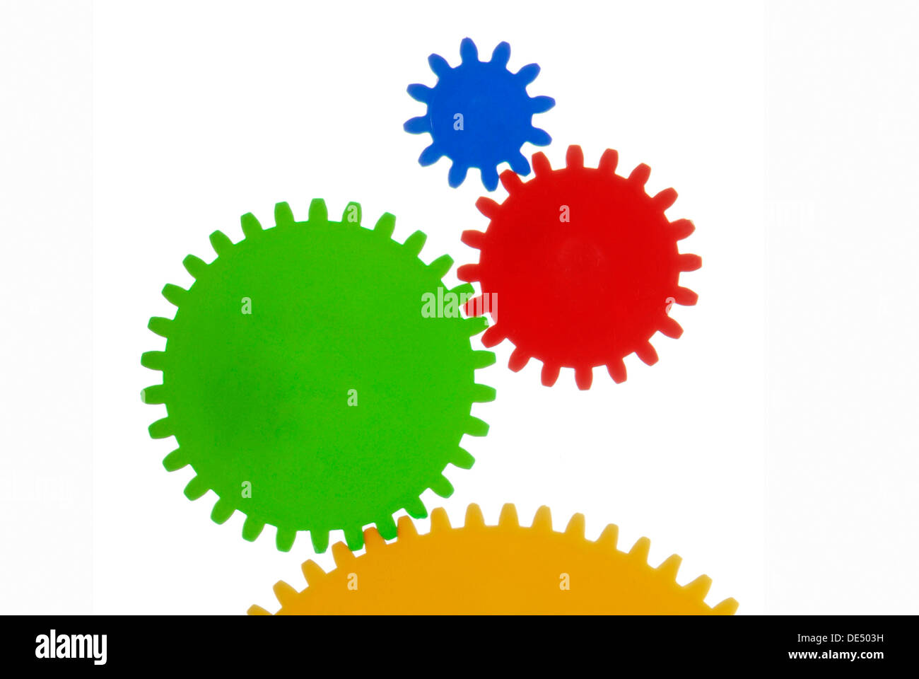 Gears with different colours and sizes, symbolic image for collaboration - Stock Image