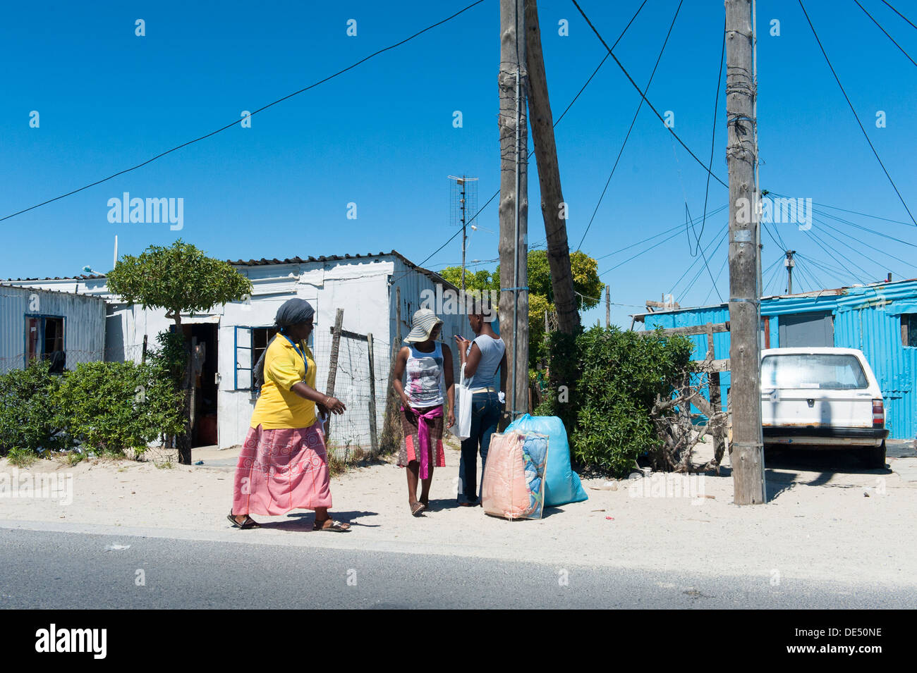 Pedestrians in Khayelitsha, a partially informal township in Cape Town, Western Cape, South Africa Stock Photo