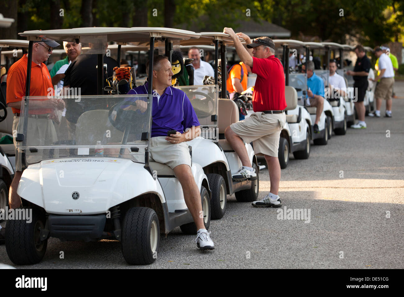 Golfers wait with their carts parade for the start of a golf tournament in Bella Vista, Arkansas. - Stock Image