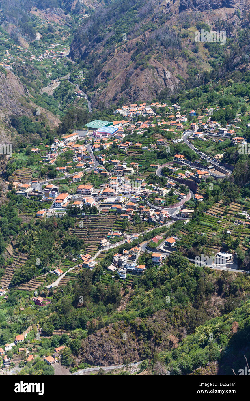 View of the village of Curral das Freiras seen from Pico dos Barcelos mountain, with its deep gorges, Funchal Pico dos Barcelos - Stock Image