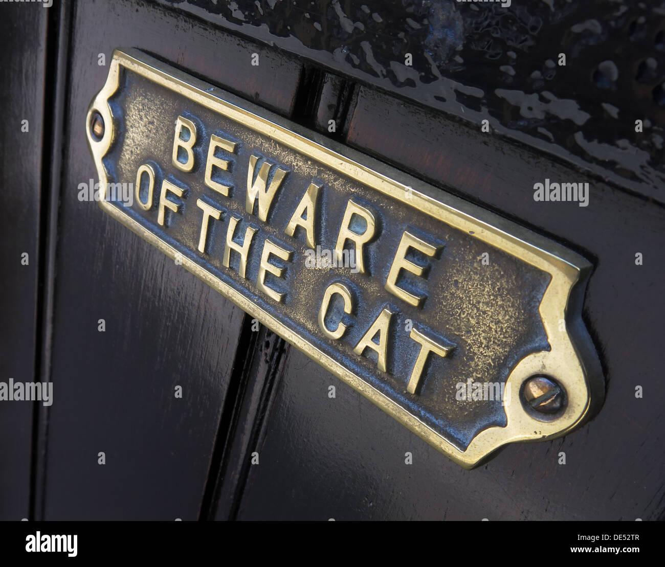 Beware of the cat sign on a door - Stock Image