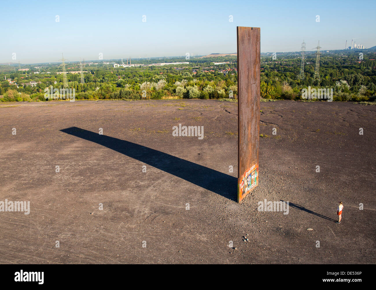 """Sculpture """"Bramme"""" on an artificial hill, a stockpile. 20 Meters high steel slab. Essen, Germany. Stock Photo"""