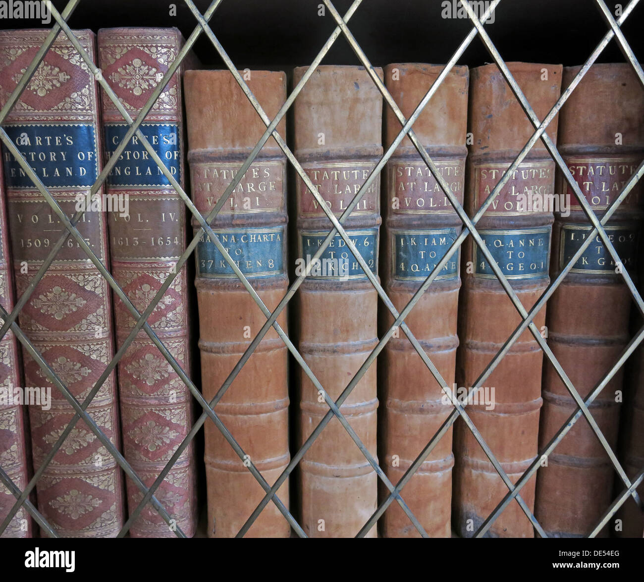 Old antique books in a library,locked away Stock Photo