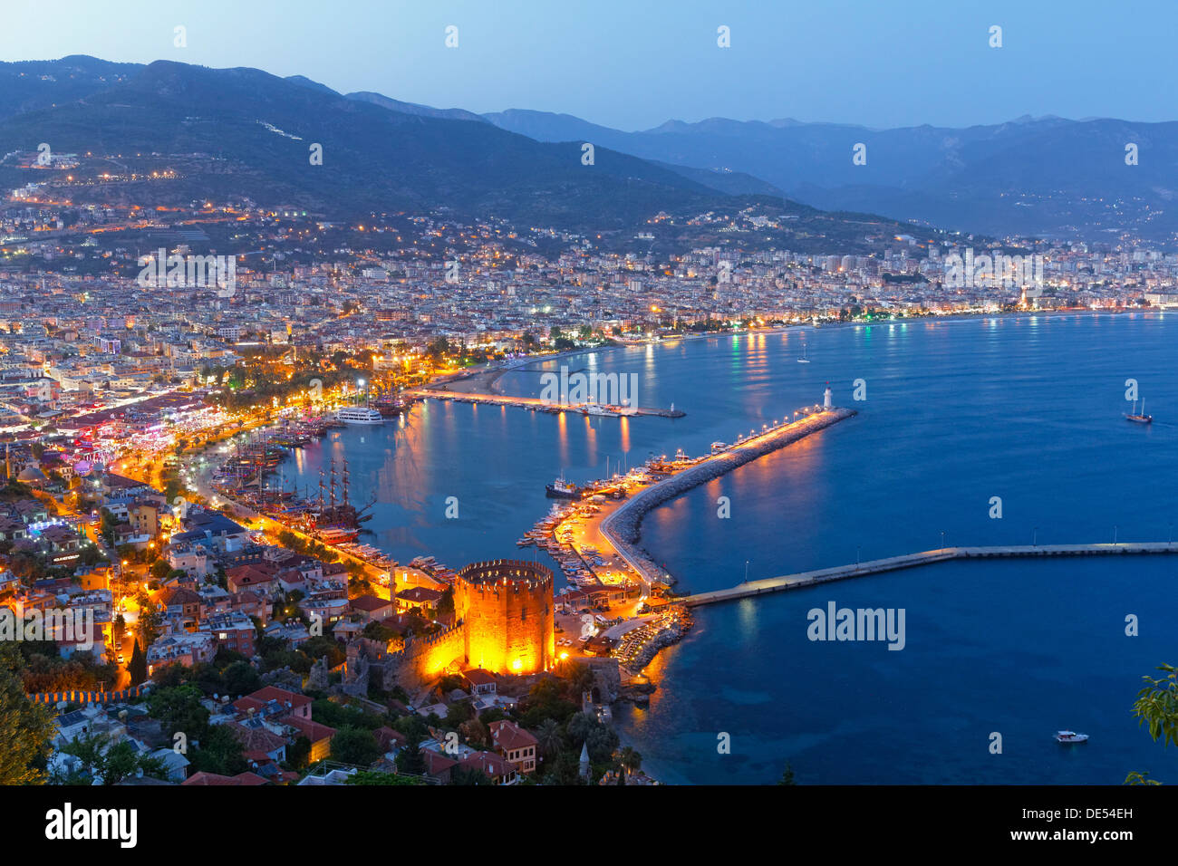 Historic town centre of Alanya with the port and Kızıl Kule or Red Tower, view from Castle Hill, Alanya, Turkish Riviera - Stock Image