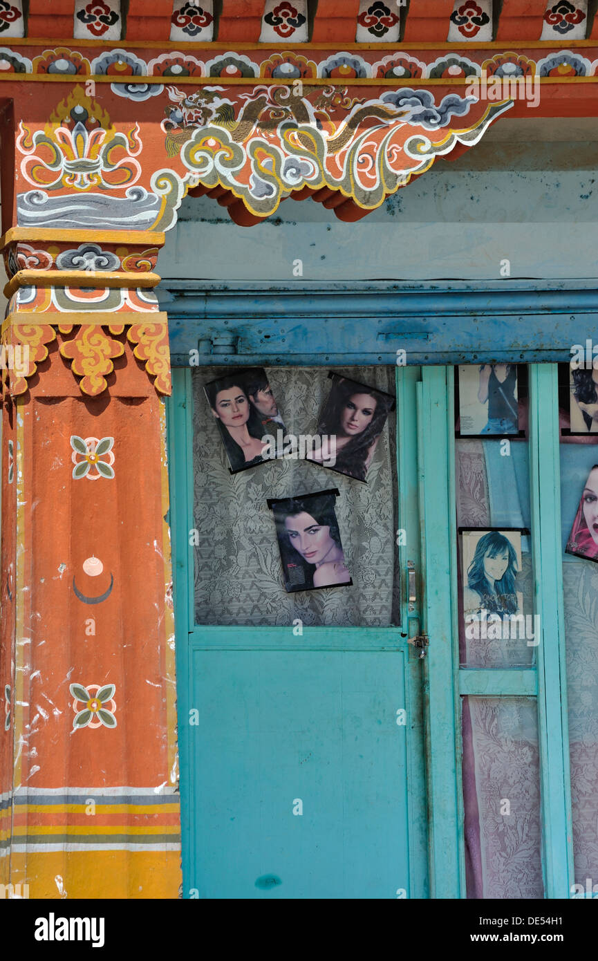Beauty parlour with Western style photos in the window and traditional architectural detail on the left, Paro, Bhutan - Stock Image