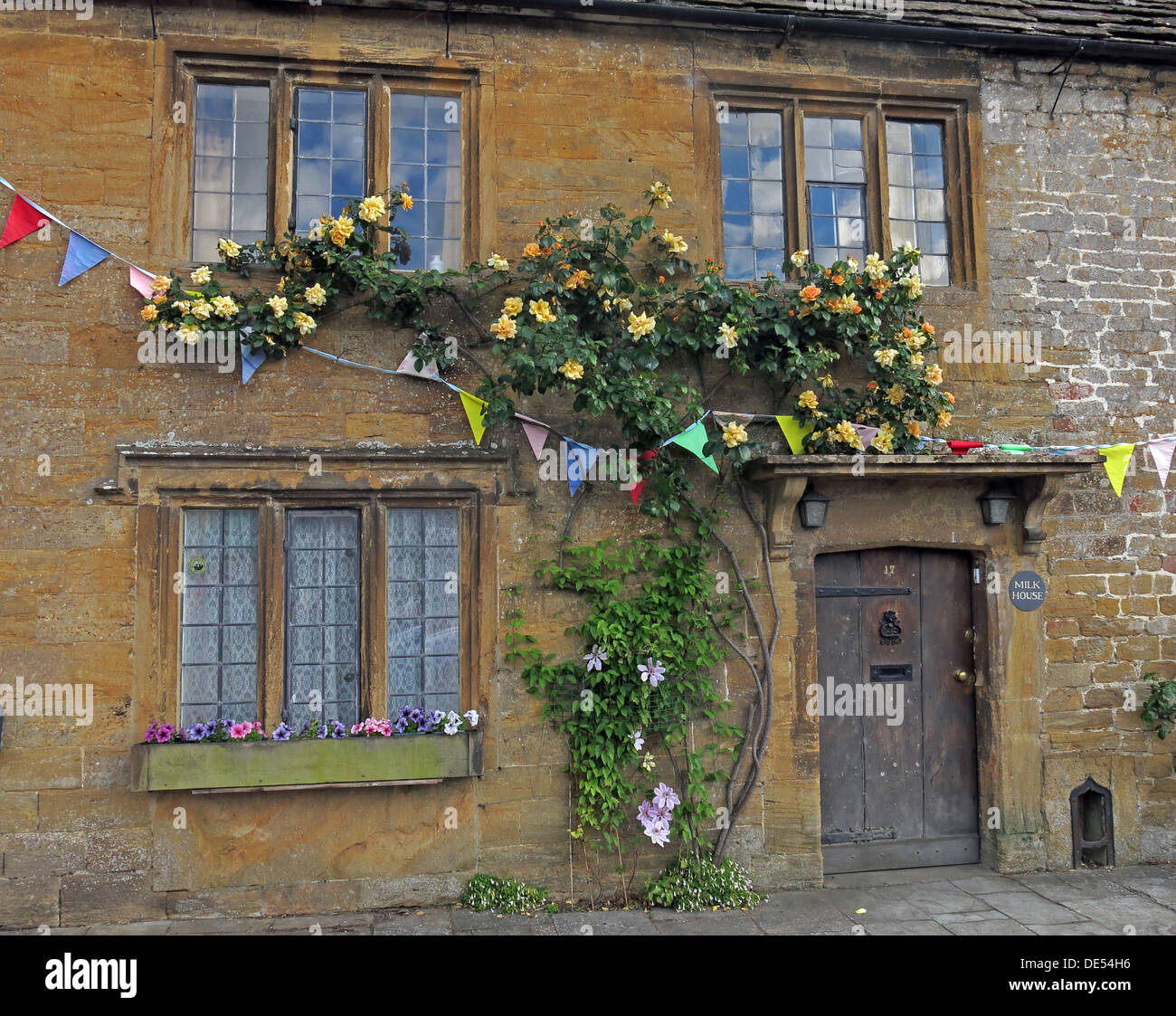 Milk House, Montecute Village,South Somerset,England,UK with climbing roses - Stock Image