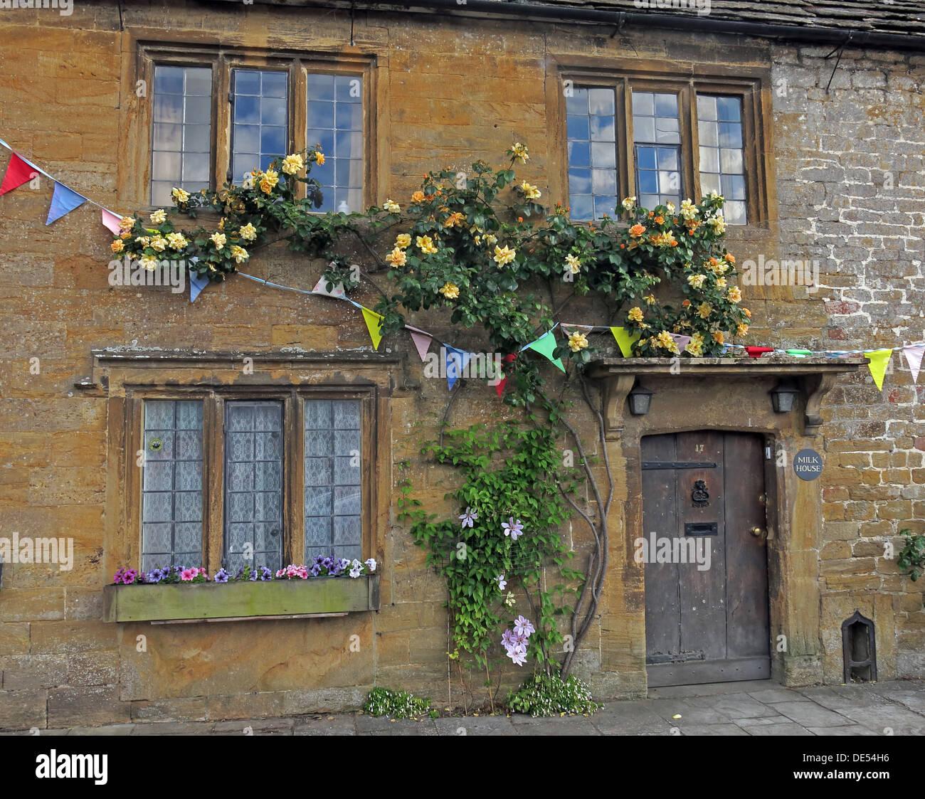 Milk House, Montecute Village,South Somerset,England,UK with climbing roses Stock Photo