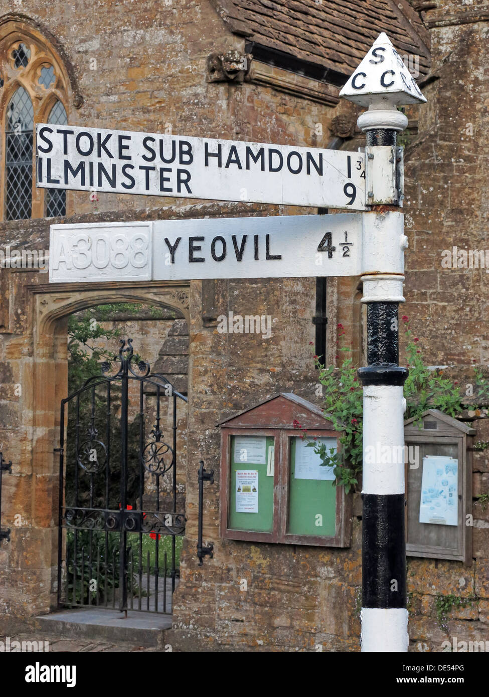 Old South Somerset CC finger post road sign Yeovil Ilminster Stoke Sub Hamdon, in centre of Montecute Stock Photo