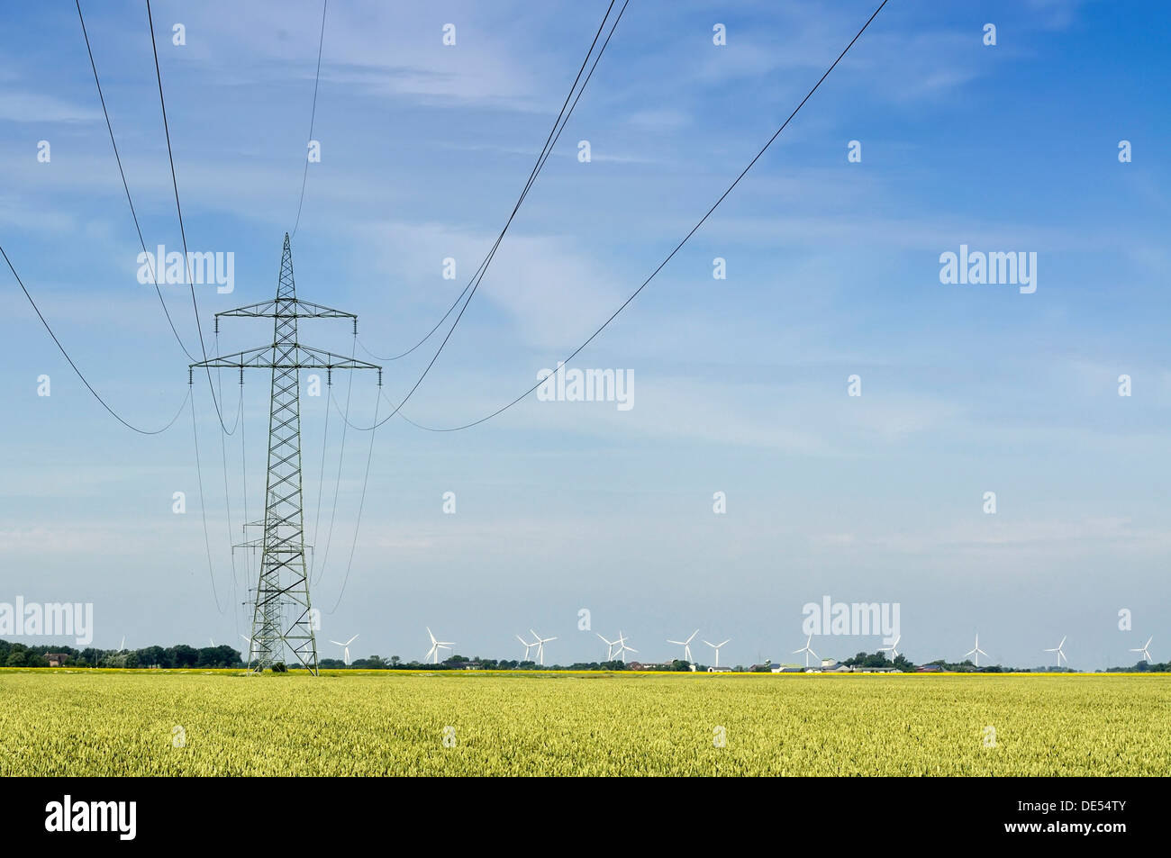 Grid connection and electricity feed-in of onshore wind energy, 110 kV high-voltage electricity line in the Gotteskoog polder - Stock Image