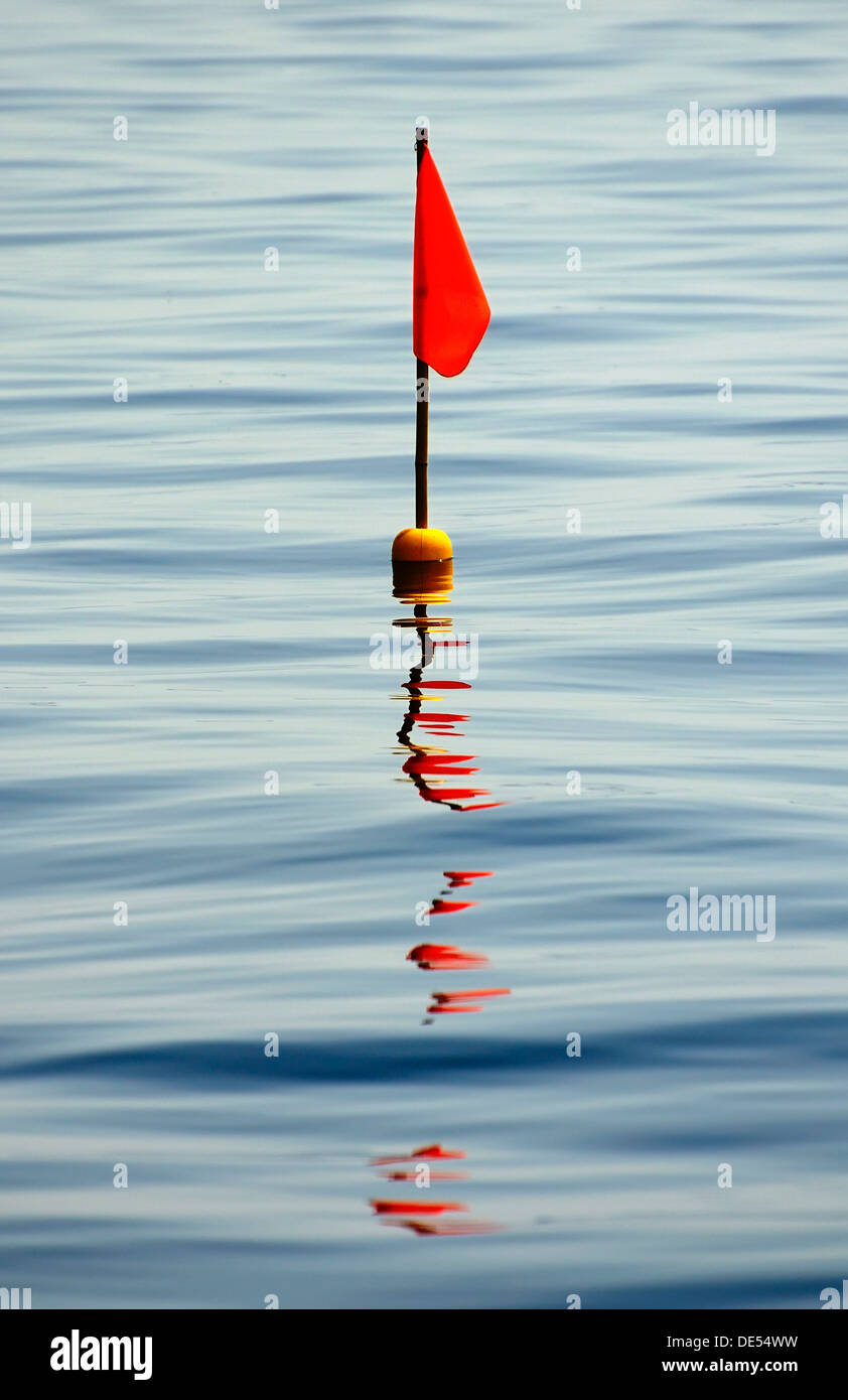 Buoy with a red flag, Mueritz, Mecklenburg-Western Pomerania - Stock Image