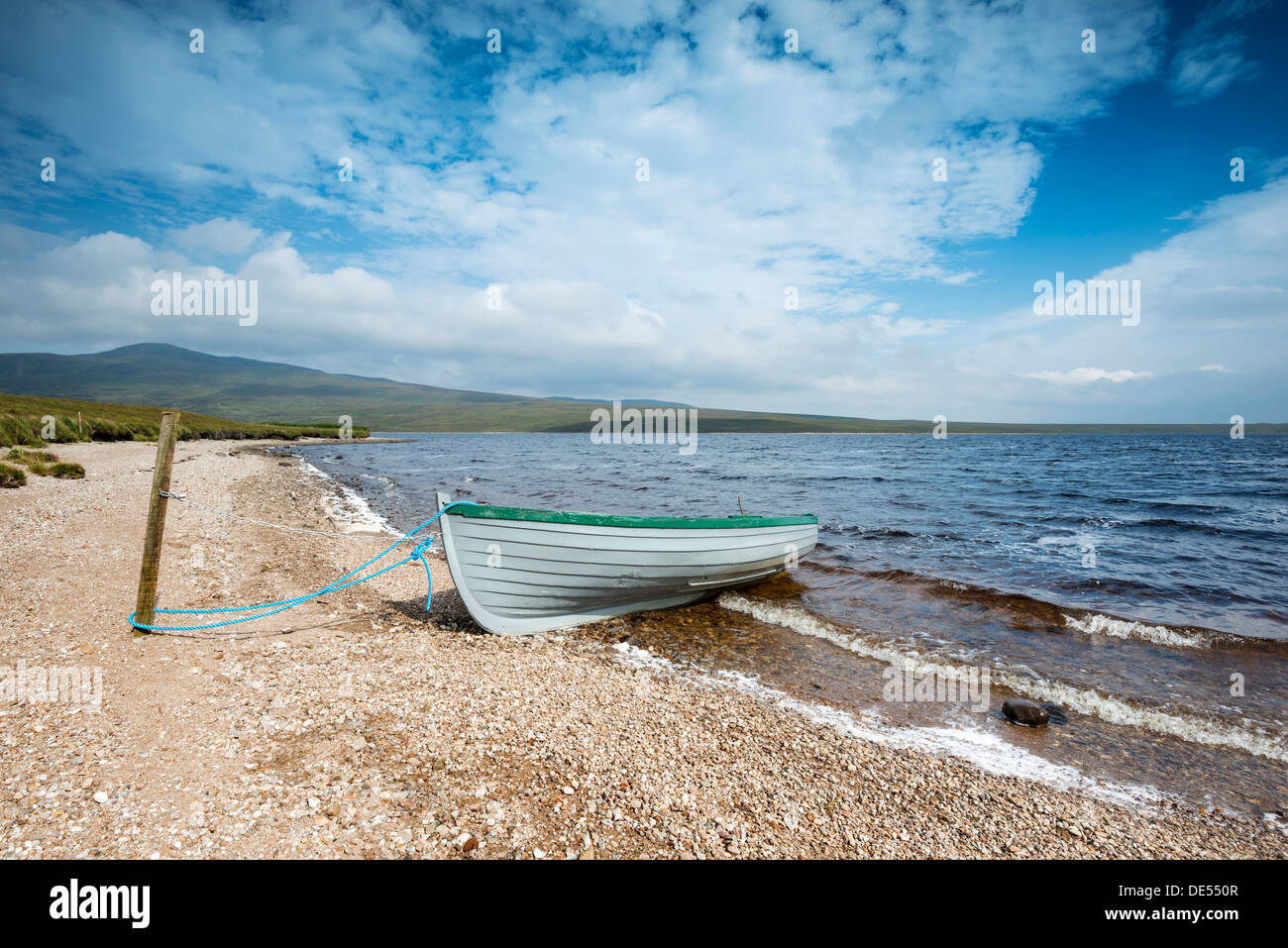 Fishing boat on the shore of Loch Loyal, Sutherland, Scotland, Great Britain, Europe - Stock Image