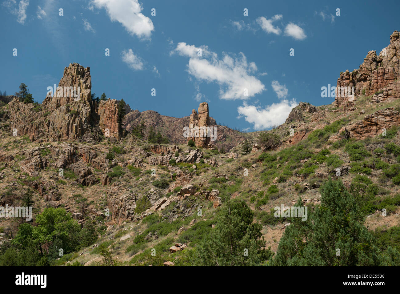 Some interesting rock spires next to Colorado's Cache La Poudre River, just west of the highway tunnel on State Route 14. - Stock Image
