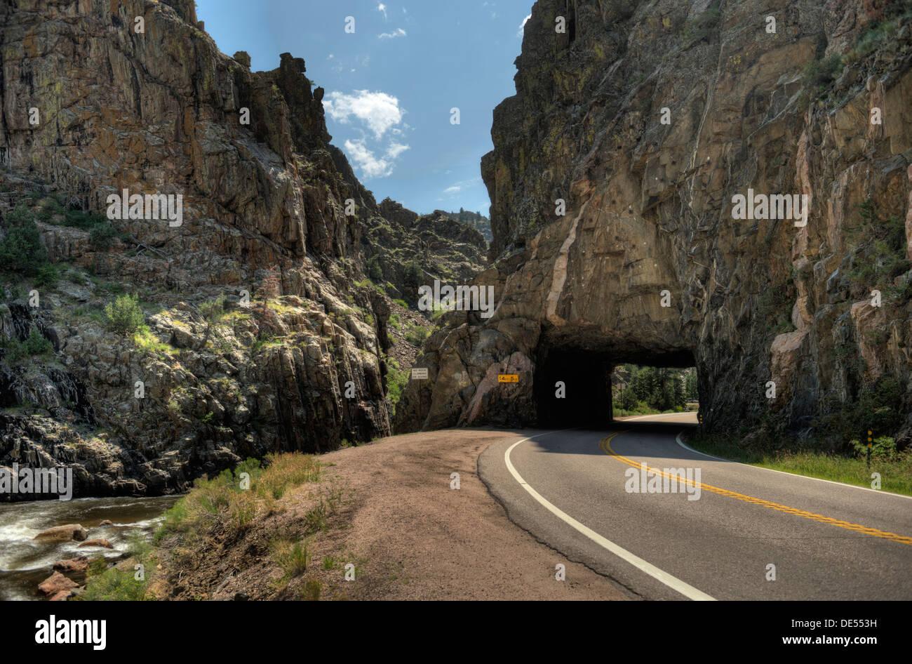 The tunnel at milepost 107, Colorado State Route 14, on the Cache La Poudre River. - Stock Image
