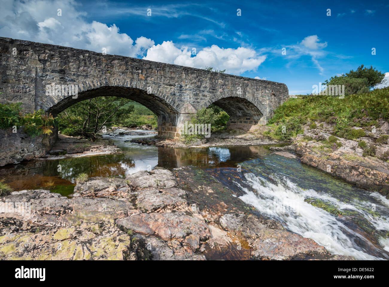 Old stone bridge across the Strath Beag River, Polla, Northern Highlands, Scotland, United Kingdom - Stock Image