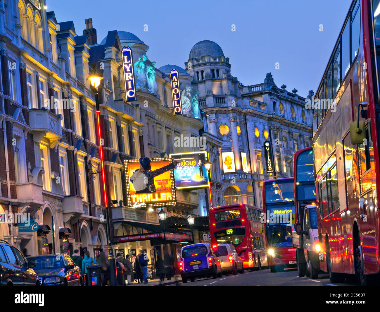 London Theatreland entertainment capital busy with people red buses and taxis in Shaftesbury Avenue West End London UK - Stock Image