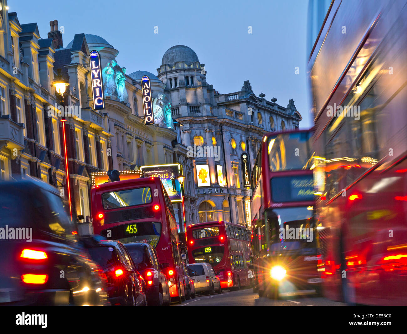 GRIDLOCK TRAFFIC JAM Theatreland traffic blurred busy with red buses and taxis in Shaftesbury Avenue West End London UK - Stock Image