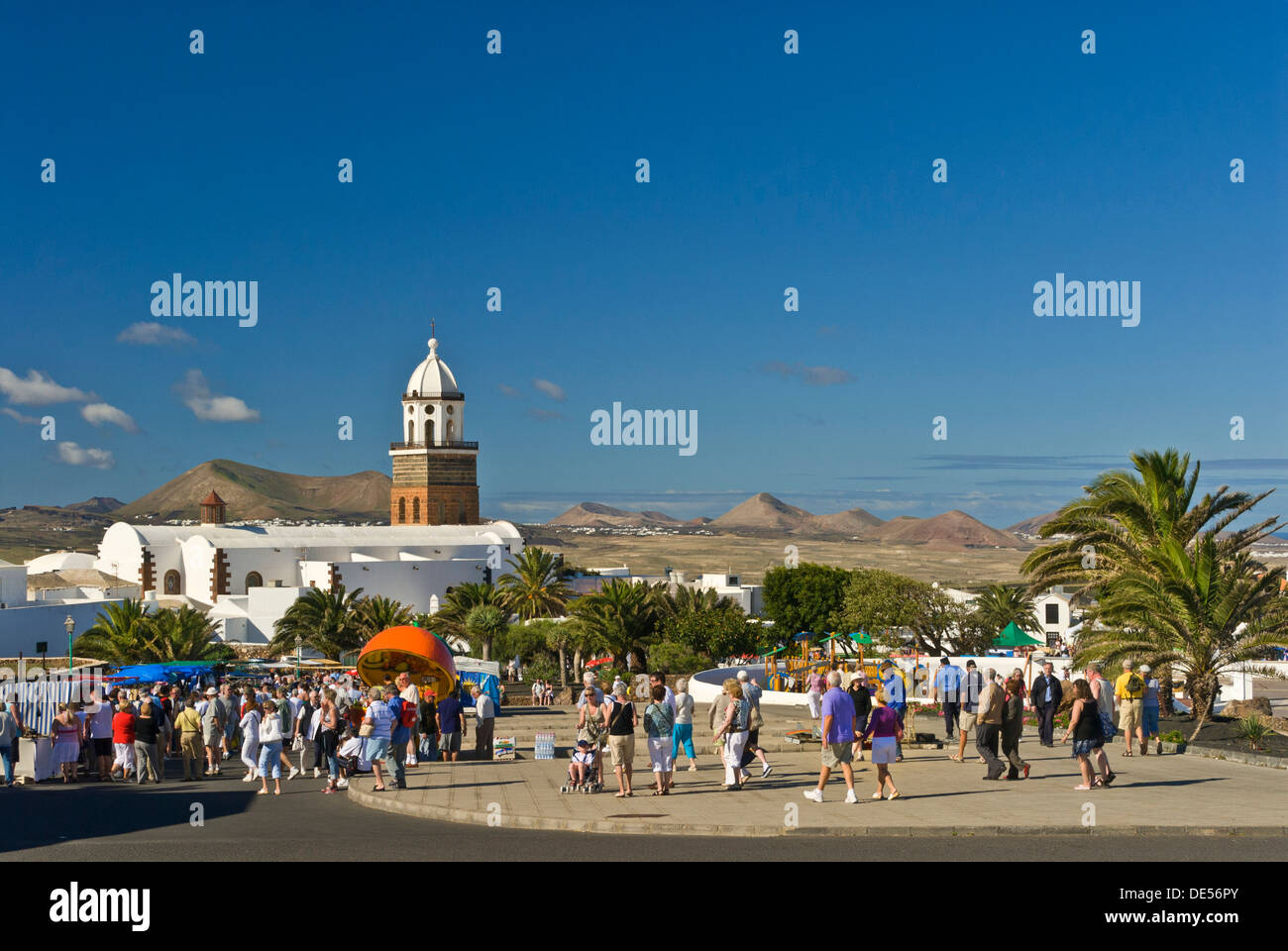 Tourists visiting popular Sunday market day in Teguise old town Lanzarote Canary Islands Spain - Stock Image