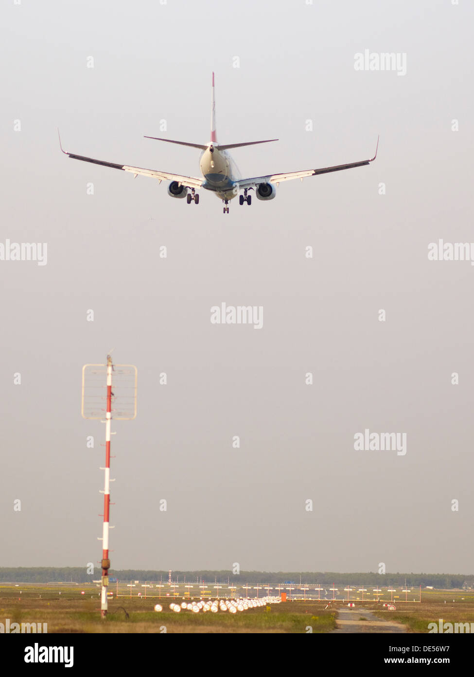 Twin engine jet plane on landing approach, Frankfurt Airport, Frankfurt am Main, Hesse - Stock Image