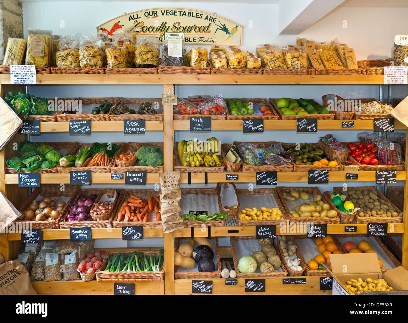 Traditional high street produce farm shop interior with fresh local fruit and vegetables on sale Stow on the Wold Cotswolds UK - Stock Image