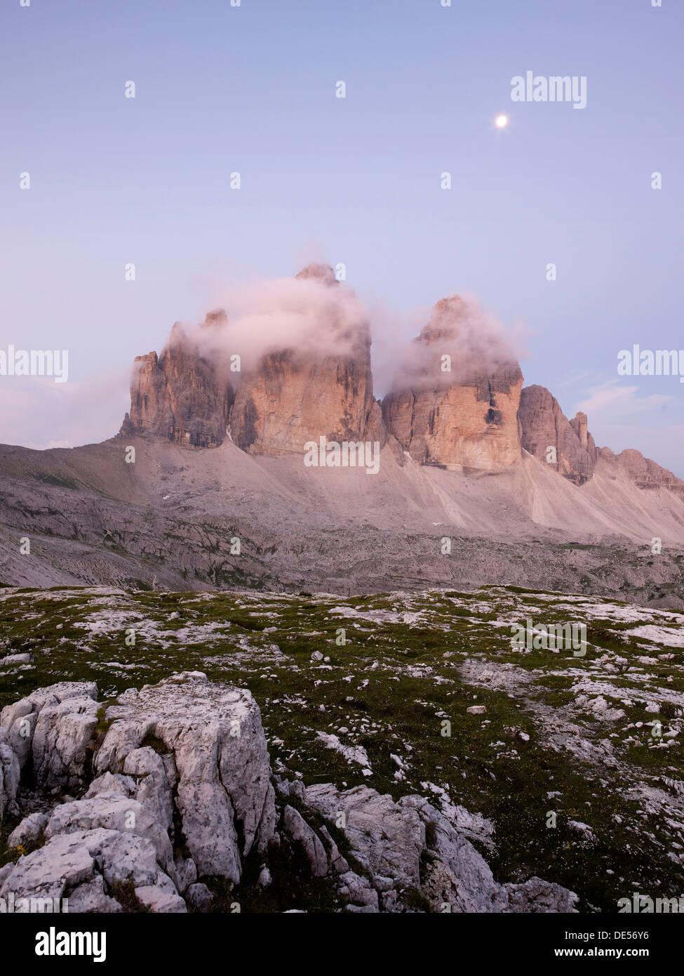 The peaks of Tre Cime di Lavaredo at dawn, Dolomiti di Sesto National Park, Sexten Dolomites, Hochpustertal, High Puster Valley - Stock Image