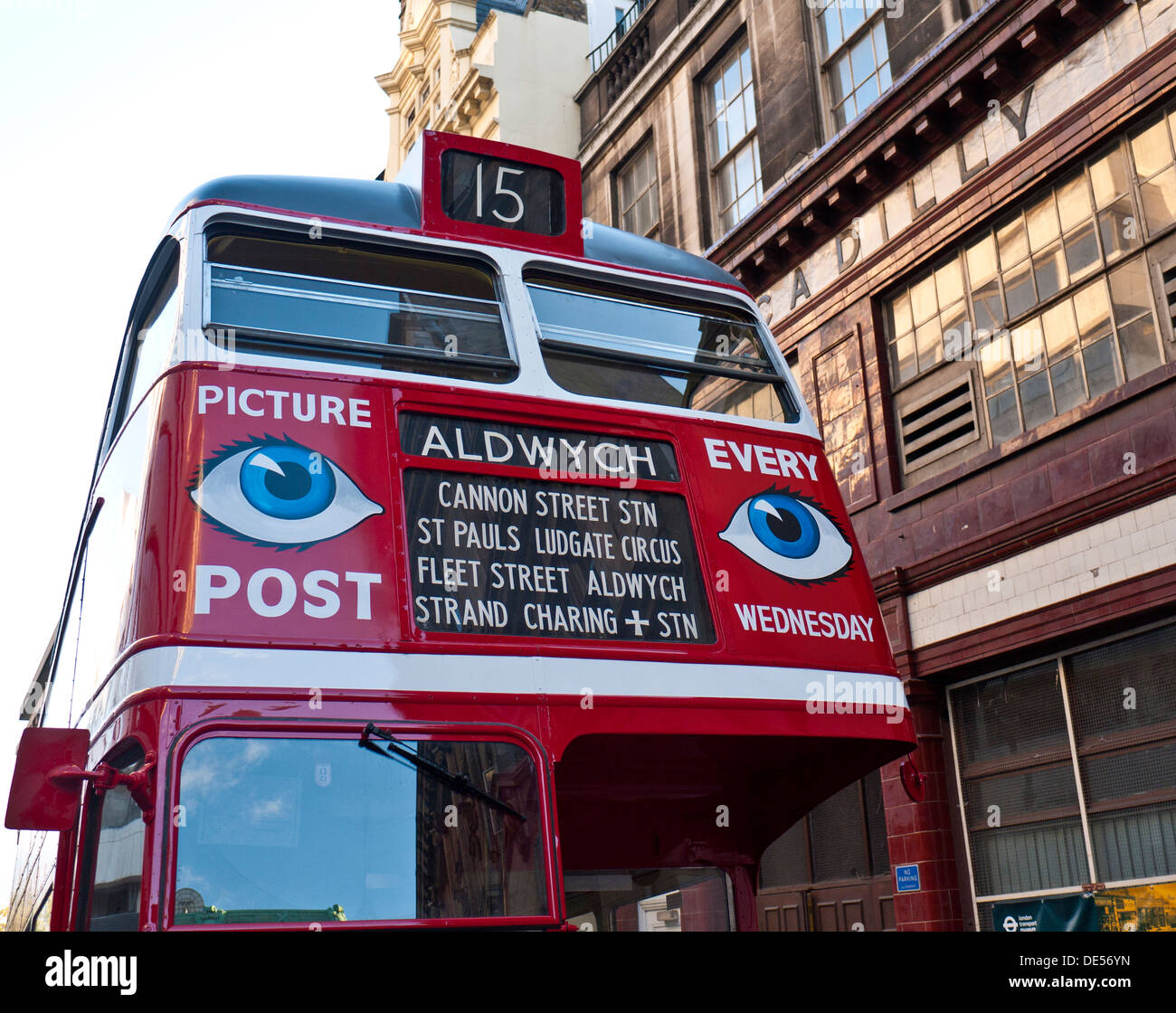 Historic 1940's restored traditional UK red double decker bus, with war time advertising posters for Picture Post magazine - Stock Image