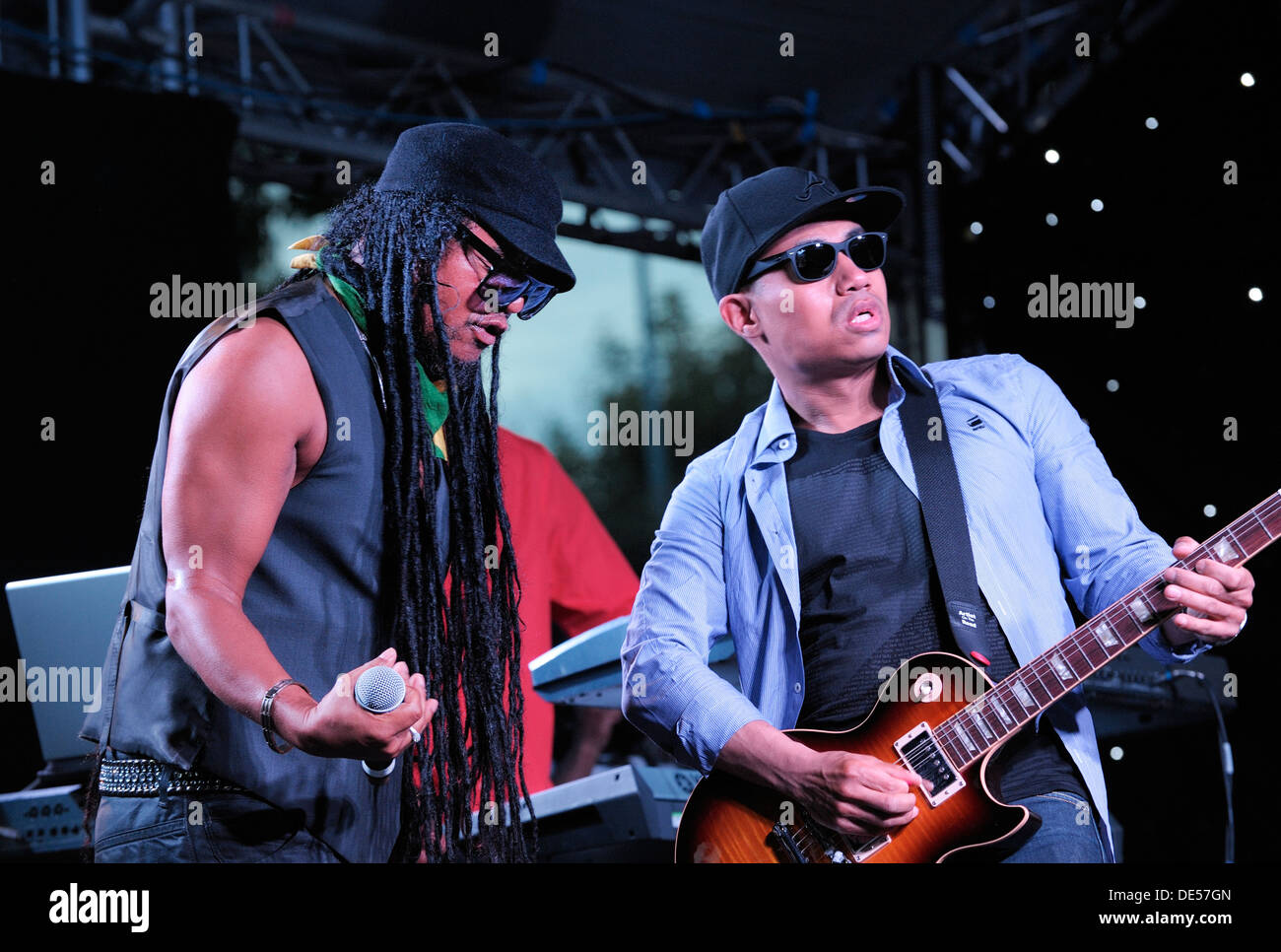 Jamaican British singer Maxi Priest and lead guitarist at the The Flyover Show, Hockley Circus, Birmingham, England, August 2012 - Stock Image