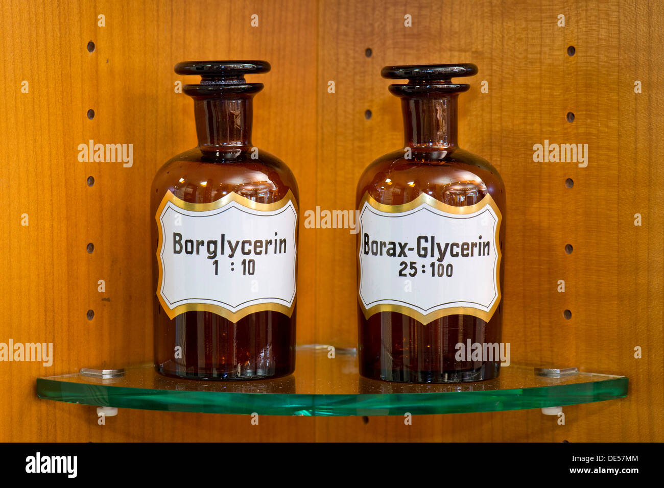 Old glass bottles for medical ingredients labeled glycerin in a pharmacy, Stuttgart, Baden-Wuerttemberg - Stock Image