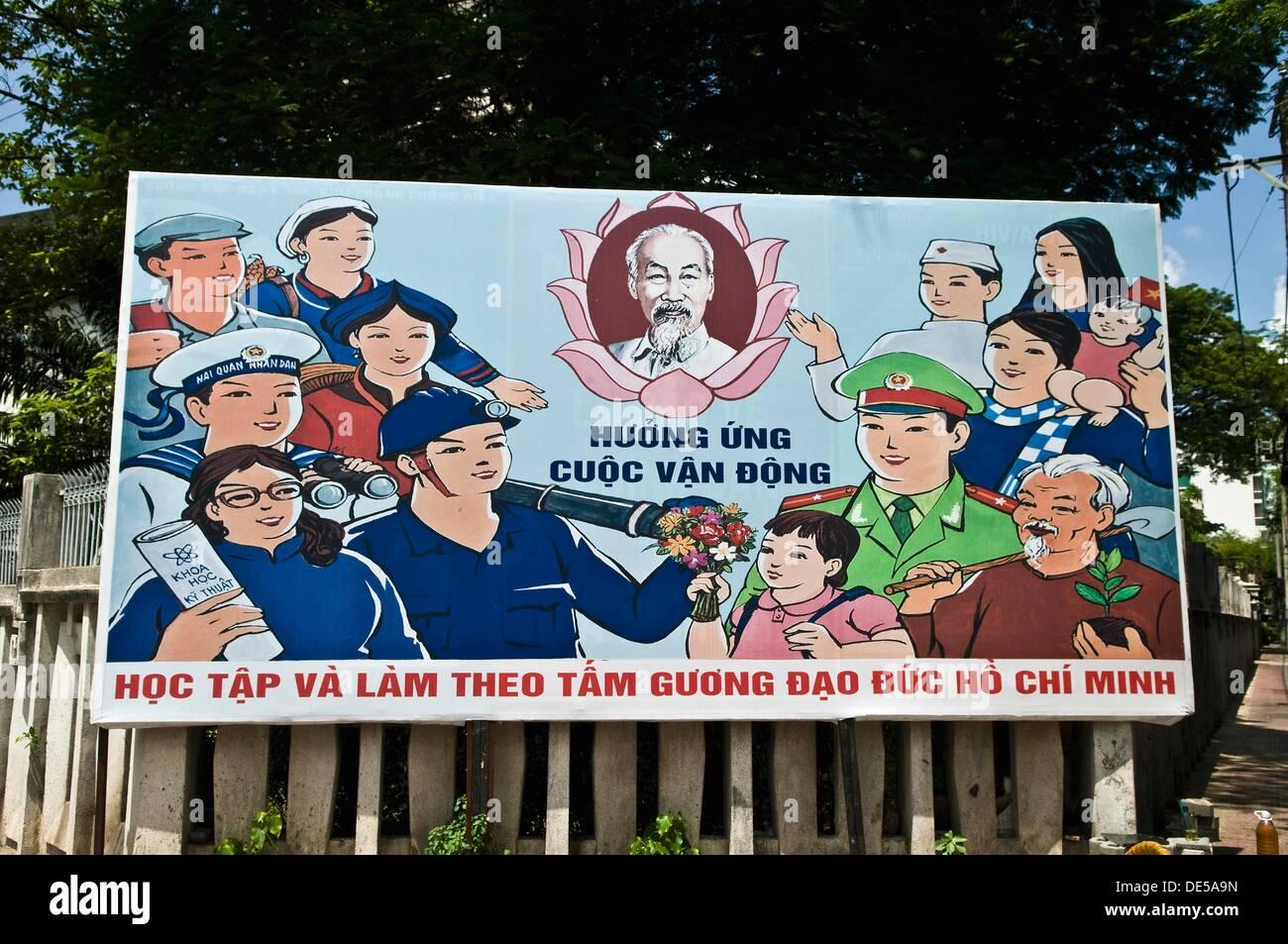 Government propaganda / advertisement for the locals as seen in Saigon, Vietnam. - Stock Image