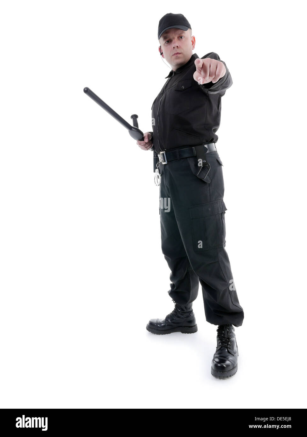 Policeman wearing black uniform pointing in ordering manner - Stock Image