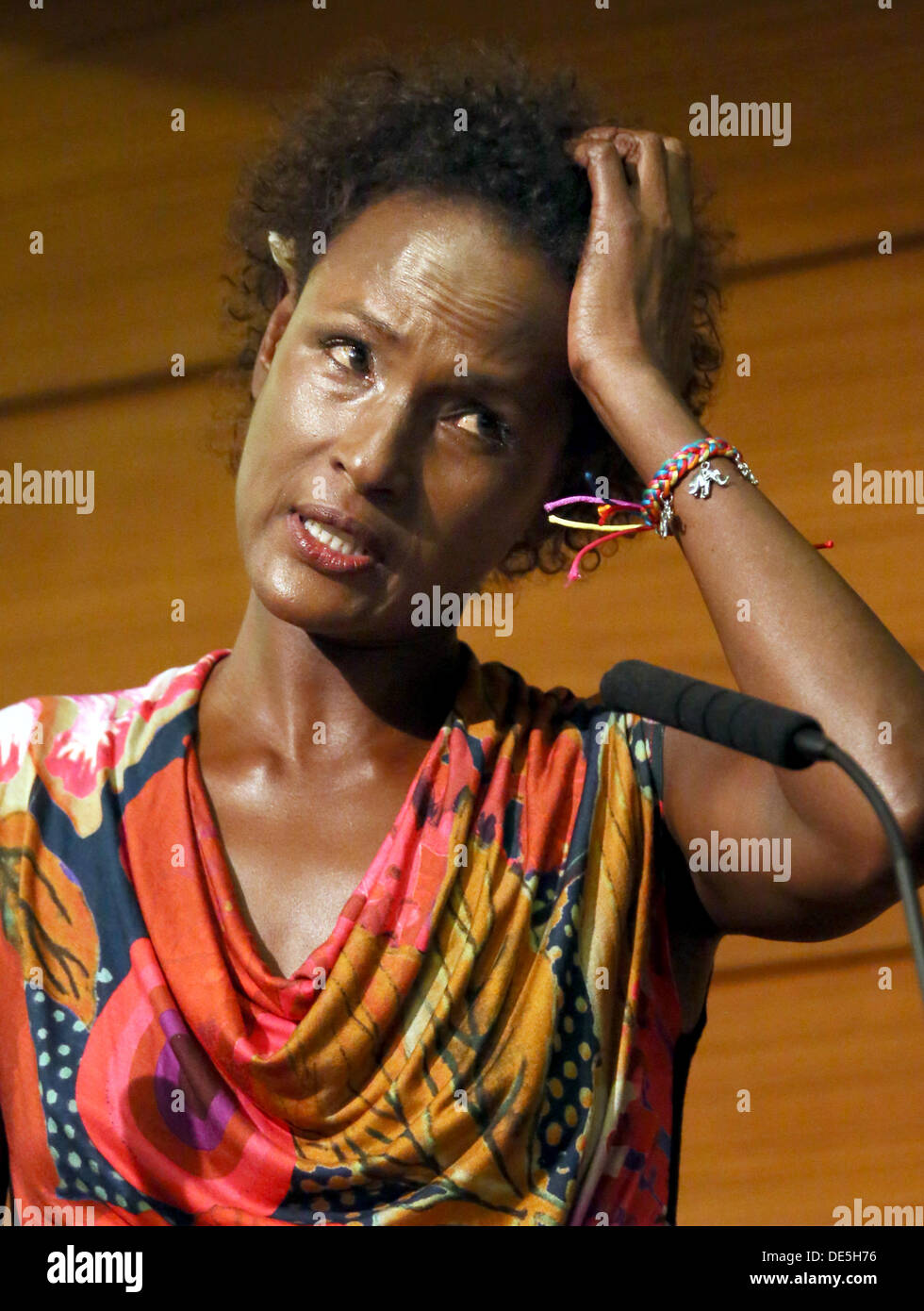 Waris Dirie, Somalian author of the bestseller 'Forest Flower' and activist against female genital cutting speaks at the opening of the 'Desert Flower Centre' of which she is a patron at hospital Waldfriede in Berlin, Germany, 11 September 2013. The centre is the first hospital in Europe that treats women with femal gentical cutting psychologically and surgically. Photo: STEPHANIE PILICK - Stock Image