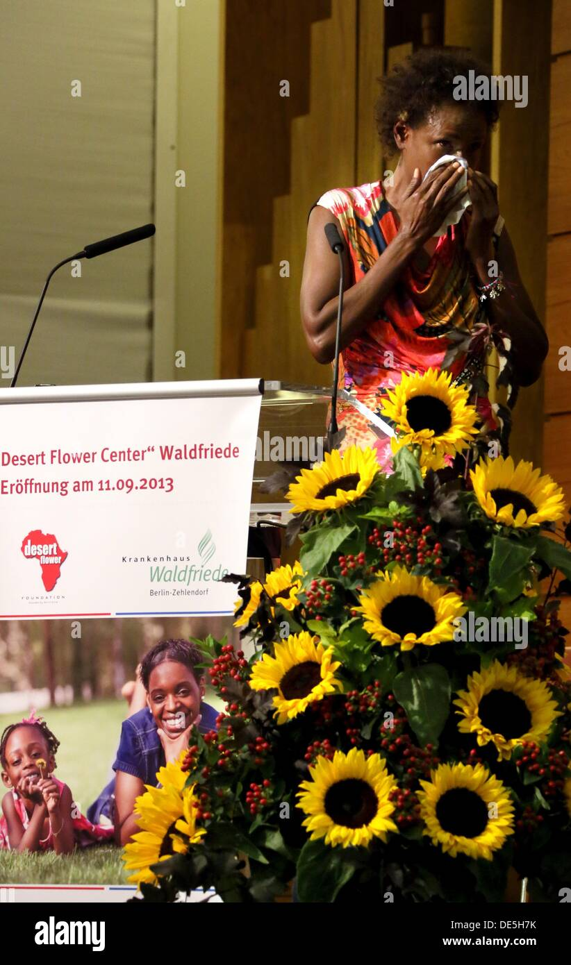 Waris Dirie, Somalian author of the bestseller 'Forest Flower' and activist against female genital cutting wipes tears from her face during her speech at the opening of the 'Desert Flower Centre' of which she is a patron at hospital Waldfriede in Berlin, Germany, 11 September 2013. The centre is the first hospital in Europe that treats women with femal gentical cutting psychologically and surgically. Photo: STEPHANIE PILICK - Stock Image