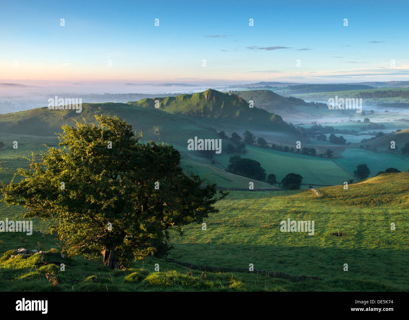 Dawn light hits Parkhouse Hill in the Peak District National Park Derbyshire England - Stock Image