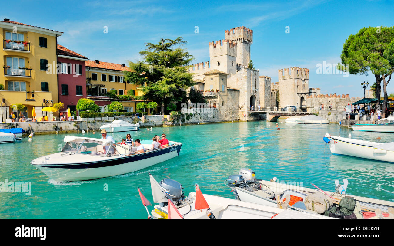 Sirmione on Lake Garda, Lombardy, Italy. Ancient town and tourist centre. Pleasure boat trips and the 13 C. Scaliger Castle - Stock Image