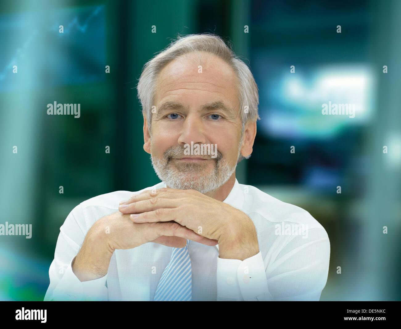 Businessman, senior, optimistic and happy expression - Stock Image