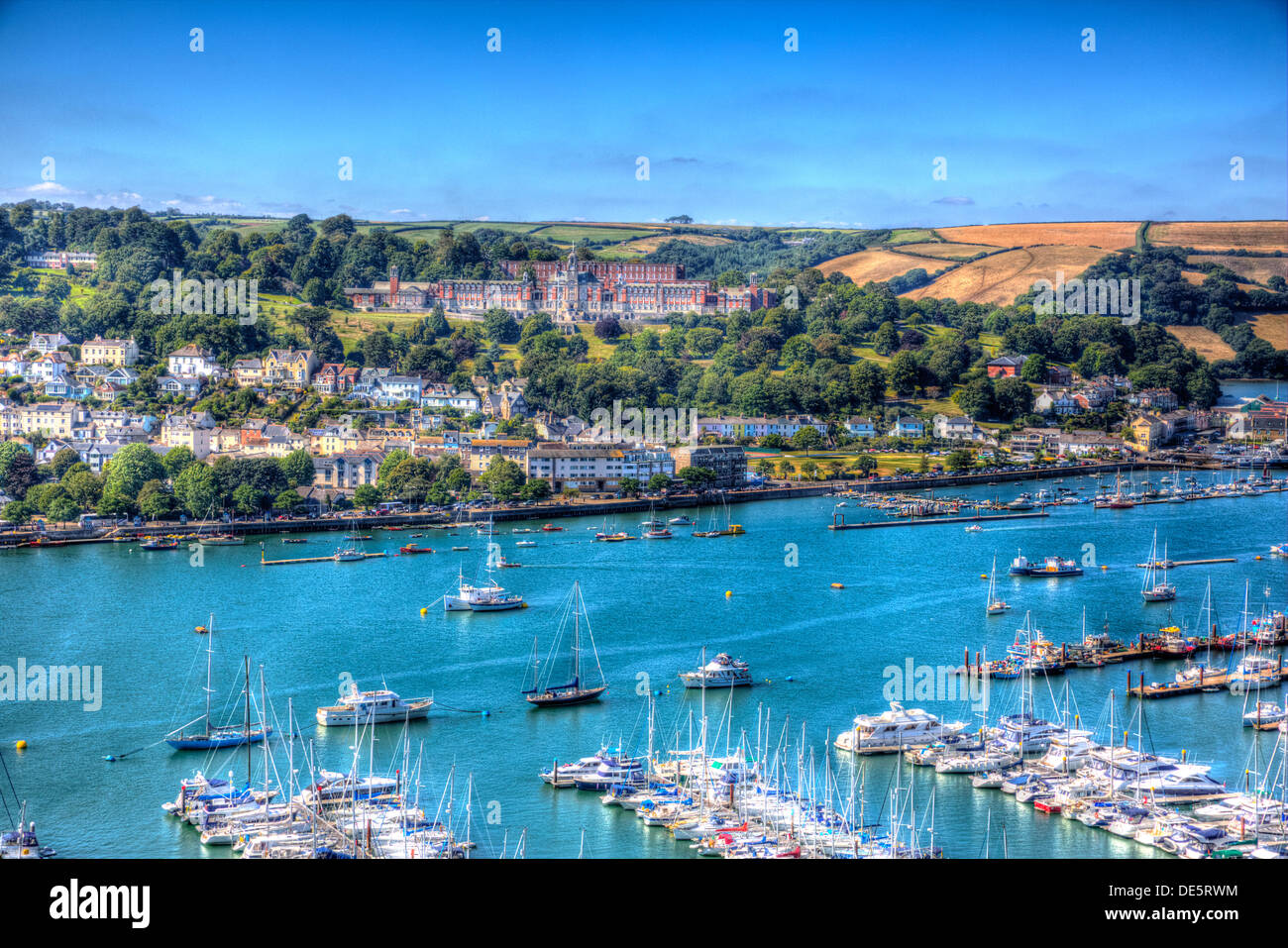 Dartmouth boats and harbour and Naval College Devon England with blue sky in HDR Stock Photo
