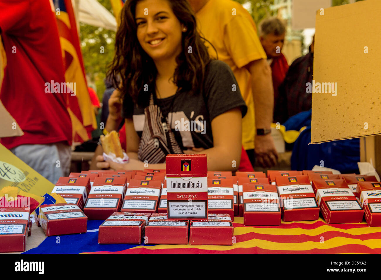 Barcelona, Spain. September 11th, 2013: Countless Catalan devotional objects  in all forms and variations are sold to the masses on September 11th, Catalonia's national day © matthi/Alamy Live News - Stock Image