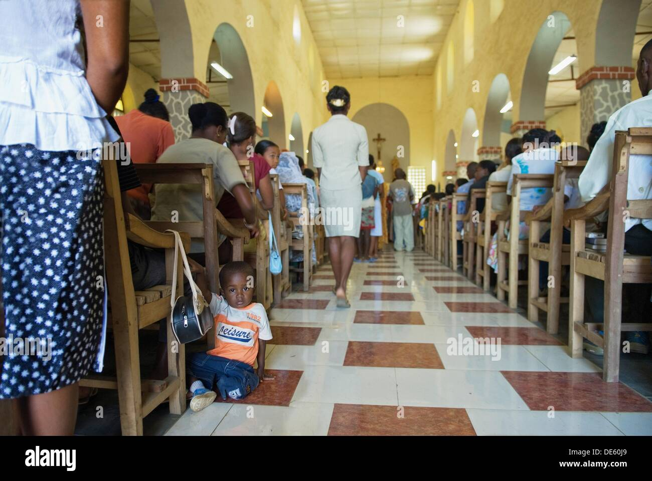 mass in the catholic church of Hell-Ville Andoany, Nosy Be island, Republic of Madagascar, Indian Ocean - Stock Image