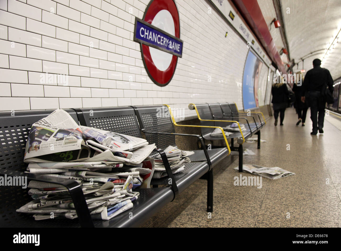 Free newspapers dumped on a bench at Chancery Lane Underground Station, during the morning commute. - Stock Image