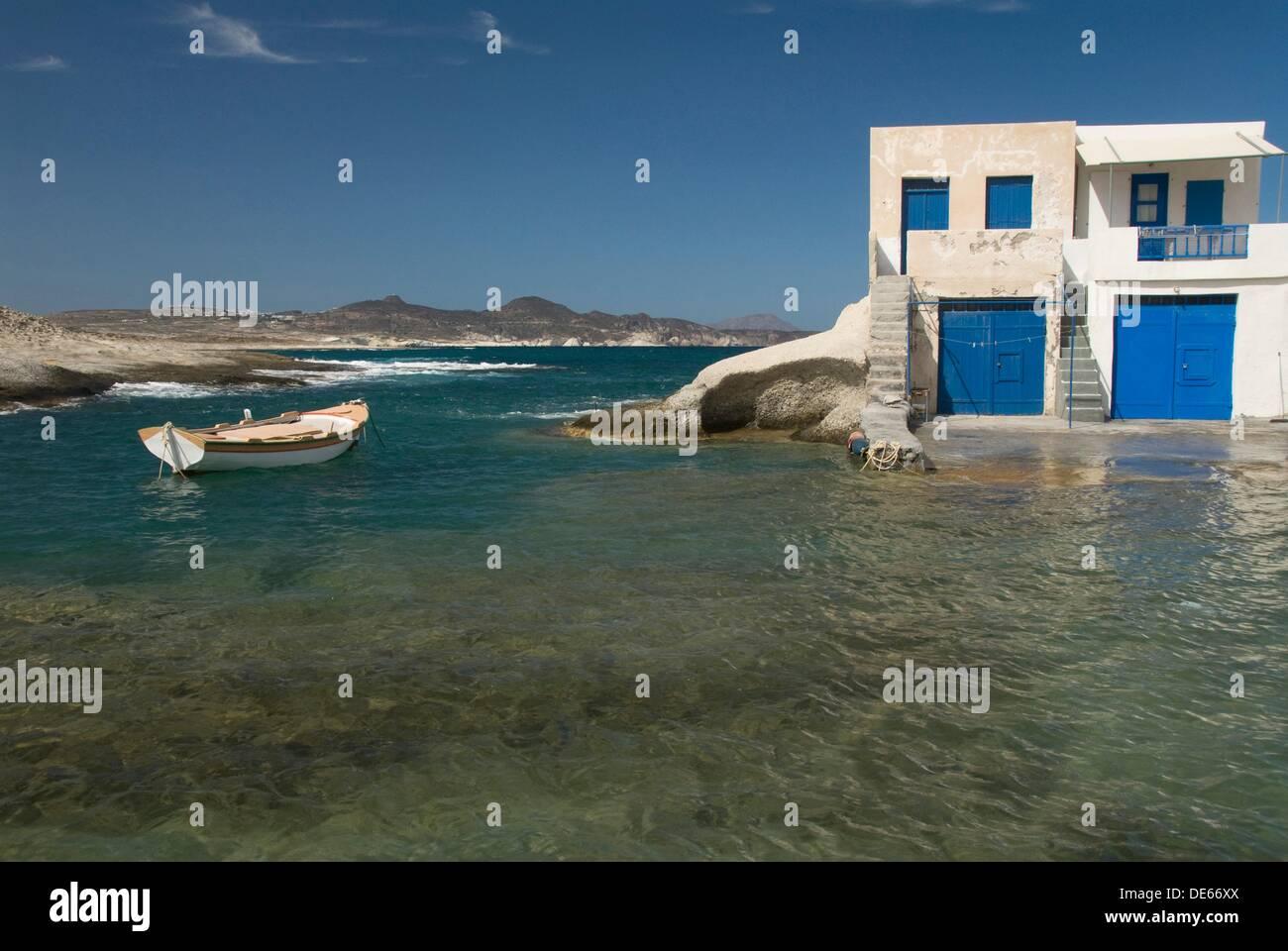 Small village near Agios Konstantinos, Island of Milos, Cyclades, Greece - Stock Image