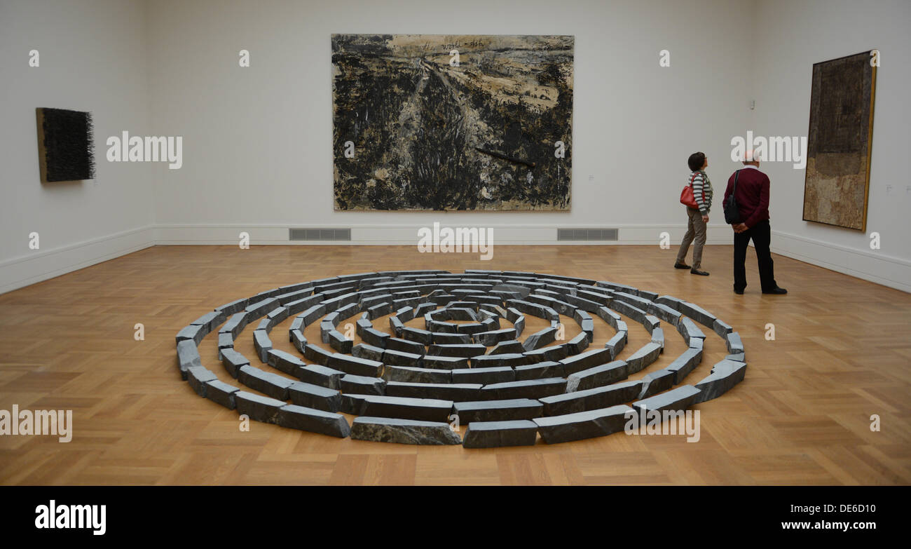 The installation 'Slate Circles' (B) by Richard Long and 'Die Weltesche' (C-T) are on display in the State Gallery in Stuttgart, Germany, 12 September 2013. Around 800 pieces are on display in the newly decorated and arranged rooms. Photo: FRANKZISKA KRAUFMANN - Stock Image