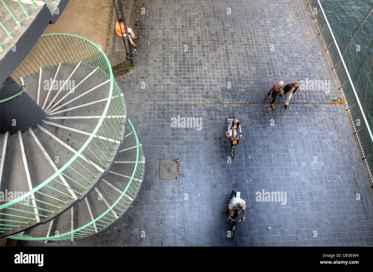 Looking down at people strolling in Cologne, Germany. - Stock Image