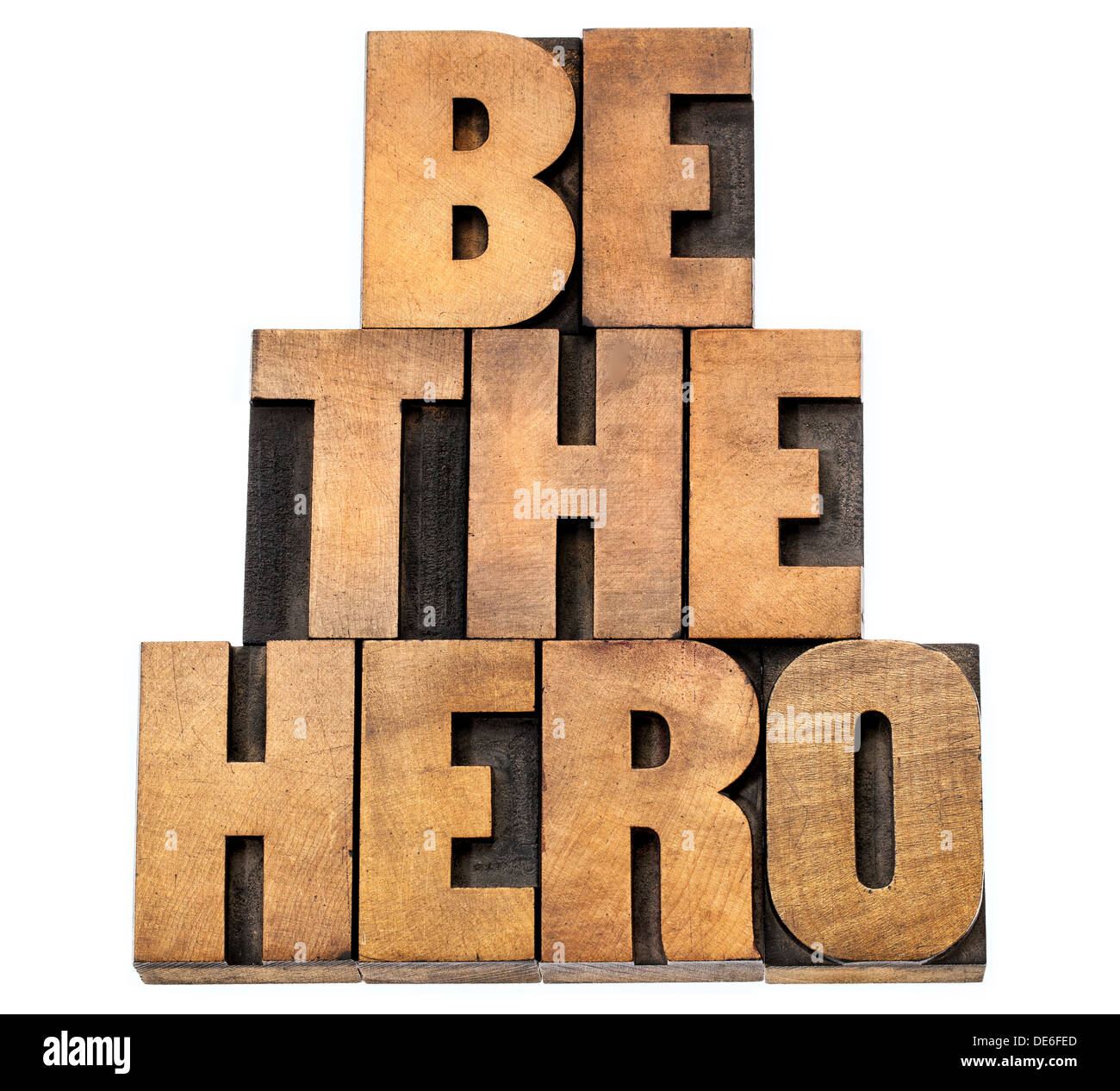 be the hero - isolated text in letterpress wood type - Stock Image