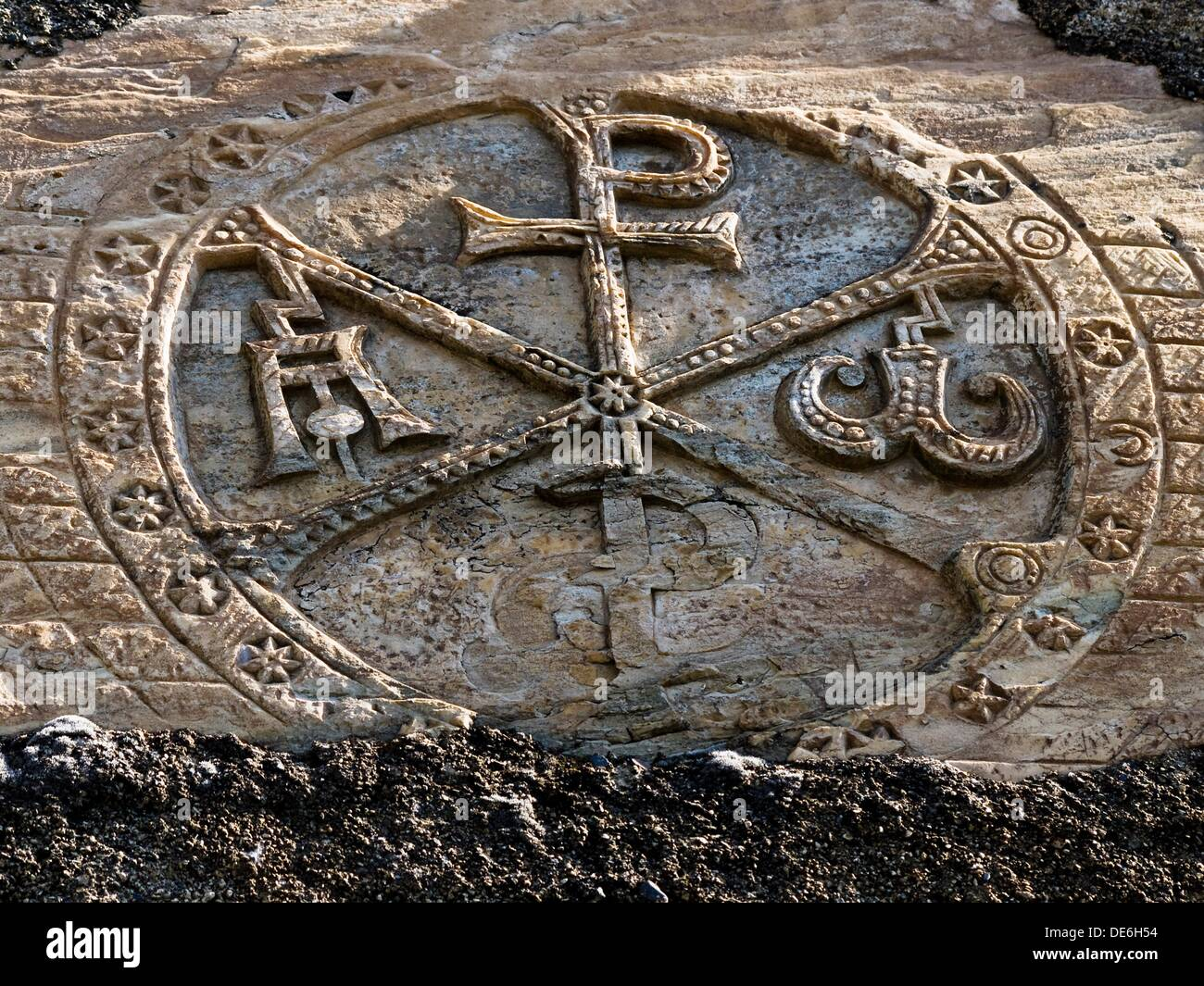 Sculpted Chi-Rho monogram (11th century) in St Nicholas´s church, Tramezaïgues, Hautes-Pyrenees, Midi-Pyrenees, Stock Photo