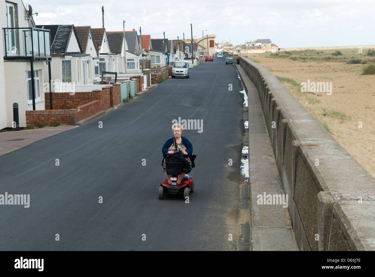 Motorised disability vehicle scooter Jaywick Essex Uk. Brooklands estate Senior oap female poverty in coastal town.  2013 2000s Uk HOMER SYKES - Stock Image
