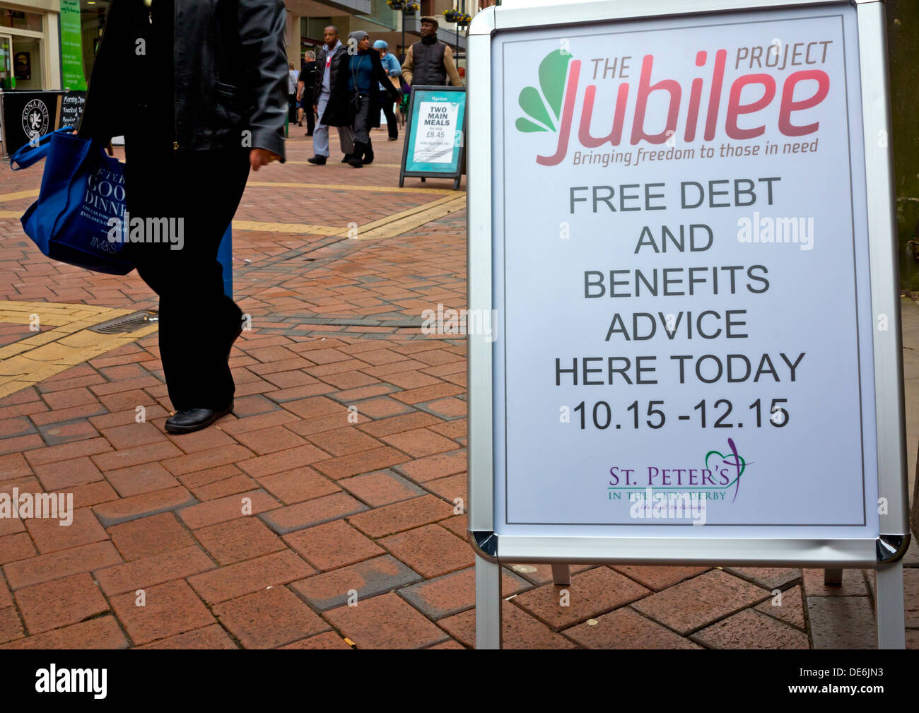 Sign advertising free debt and benefits advice in Derby city centre Derbyshire England UK - Stock Image