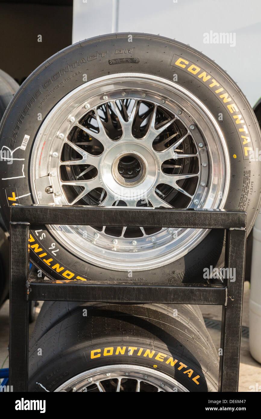Racks of Continental tires outside garages at Daytona International Speedway during the 2012 Rolex 24 at Daytona, Florida - Stock Image