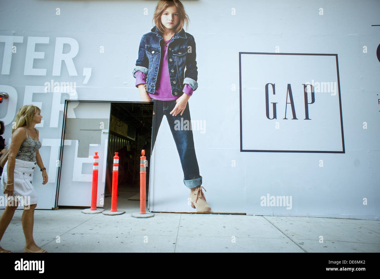A construction shed covers the front of a Gap store as it gets spruced up, in the Flatiron neighborhood of New York - Stock Image